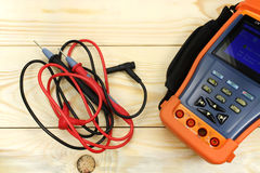 Digital multimeter on a wooden table stock images