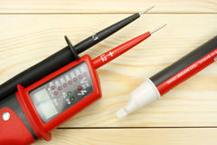Digital multimeter on a wooden table royalty free stock photo