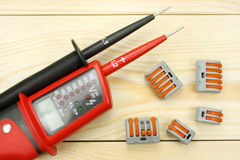Digital multimeter on a wooden table royalty free stock image