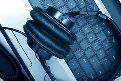 Digital Music Composer. Theme. Modern Laptop Computer and Large Professional Headphones.  Workstation. Technology Photo Collection stock photos