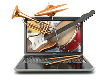 Digital music composer concept. Laptop and musical instruments. Royalty Free Stock Photography