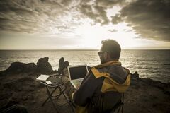 Free Digital Nomad People At Work Outdoor With Computer Laptop And 5g Internet Connection In Roaming Phone Hotspot - Man Travel And Stock Image - 209652281