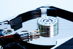 Digital numbers with opened hard disc plate Stock Photos