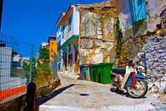 Digital painting of an old rusty moped in a  greek village Stock Images
