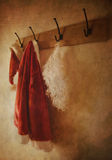 Digital painting of santa costume. Hanging on rack Stock Photos