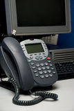 Digital phone and computer. On the workplace Royalty Free Stock Photography