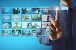 Digital photo album. Businessmen and Reaching images streaming, digital photo album Stock Photo