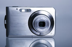 Digital photo camera. And his reflection Royalty Free Stock Images