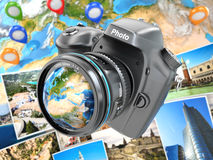 Digital photo camera on background from earth and photographs. Stock Photography