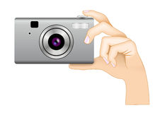 Digital photo camera in hand Royalty Free Stock Photography
