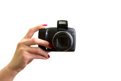 Digital photo camera in hand. On white stock image