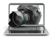 Digital photo camera and laptop. Journalist  or  traveler equipm Royalty Free Stock Image