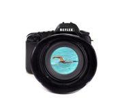 Digital photo camera with tourists swimming Stock Photo