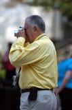 Digital Photographer. Man shoots a digital photo stock photos