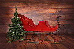 Digital Photography Background Of Red Vintage Christmas Sleigh. Digital background of red vintage wooden Christmas holiday sleigh prop on wooden backdrop for use Stock Images