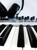 Digital piano and headphones Stock Photo