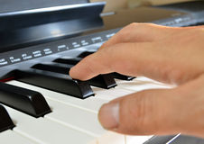 Digital piano keys and player Stock Image
