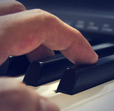 Digital piano keys and player Royalty Free Stock Photography