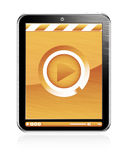 Digital play button on tablet Royalty Free Stock Photo
