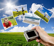 Digital point and shoot camera and pictures. Against blue sky Stock Photography