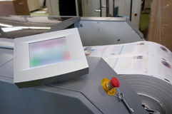 Digital press printing machine. Digital press printing is the reproduction of digital images on a physical surface. It is generally used for short print runs royalty free stock photo