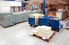 Digital press printing machine. Digital press printing is the reproduction of digital images on a physical surface. It is generally used for short print runs stock images