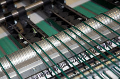 Digital press printing machine (detail). Digital press printing is the reproduction of digital images on a physical surface. It is generally used for short print royalty free stock photography