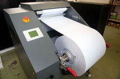 Digital press printing machine (detail). Digital press printing is the reproduction of digital images on a physical surface. It is generally used for short print royalty free stock photo