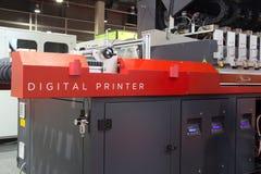 Digital Printer. VALENCIA, SPAIN - FEBRUARY 11, 2014: An industrial digital printer on display at the 2014 Feria Habitat Valencia Trade Fair stock photos
