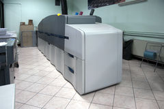 Digital printer - printing machine. Digital press printing is the reproduction of digital images on a physical surface. It is generally used for short print runs royalty free stock images