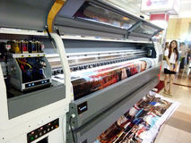 Digital printing. Engineers are showing the way digital printing machine operating in an exhibition in the city of Solo, Central Java, Indonesia stock photo