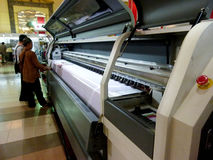 Digital printing. Sales are introducing digital printing machine at an exhibition in the city of Solo, central Jaa, Indonesia royalty free stock photos