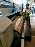 Digital printing. Sales are introducing digital printing machine at an exhibition in the city of Solo, central Jaa, Indonesia royalty free stock photography
