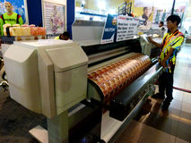 Digital printing. Sales are introducing digital printing machine at an exhibition in the city of Solo, central Jaa, Indonesia stock images