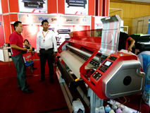 Digital printing. Sales are introducing digital printing machine at an exhibition in the city of Solo, central Jaa, Indonesia royalty free stock images