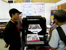Digital printing. Technicians showing the digital printing at the exhibition in the city of Solo, Central Java, Indonesia royalty free stock photo