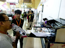 Digital printing. Technicians showing the digital printing at the exhibition in the city of Solo, Central Java, Indonesia royalty free stock image