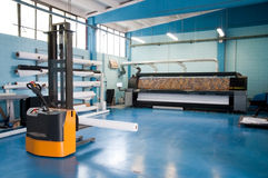 Digital printing - wide format press. Digital printing system for printing a wide range of superwide-format applications. These printers are generally roll-to royalty free stock photography