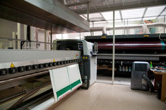 Digital printing - wide format press. Digital printing system for printing a wide range of superwide-format applications. These printers are generally roll-to stock images