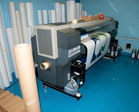 Digital printing - wide format press. Digital printing system for printing a wide range of superwide-format applications. These printers are generally roll-to royalty free stock image
