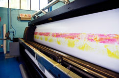 Digital printing - wide format press. Digital printing system for printing a wide range of superwide-format applications. These printers are generally roll-to stock photos