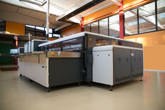 Digital printing - wide format printer. Digital printing system for printing a wide range of superwide-format applications. These printers are generally roll-to royalty free stock photo