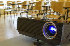Digital projector in presentation hall/auditorium. Turned on digital projector in a meeting room or auditorium. This could represent any kind of meeting stock photos