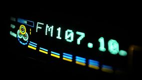 Digital radio receiver tune dial panel. Search for stations. Raising the sound stock footage