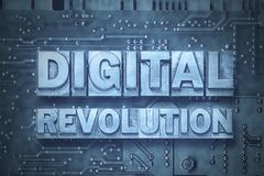 Digital revolution - pc. Digital revolution phrase made from metallic letterpress blocks on the pc board background stock image