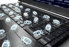 Digital safety concept electronic bug on computer keyboard Stock Images