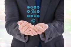 Digital sammansatt bild av affärsmannen som skyddar medicinska symboler Arkivfoton