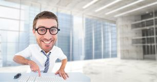 Digital sammansatt bild av den lyckliga nerden som använder datortangentbordet royaltyfria foton