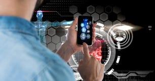 Digital sammansatt bild av mannen som använder den smarta telefonen med techdiagram i bakgrund royaltyfri foto