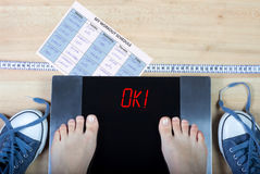 Digital scales with female feet on them and sign ok and healthy lifestyle accessories Stock Image